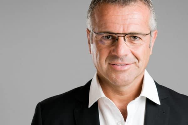 Mature man with eyeglasses looking at camera and smiling